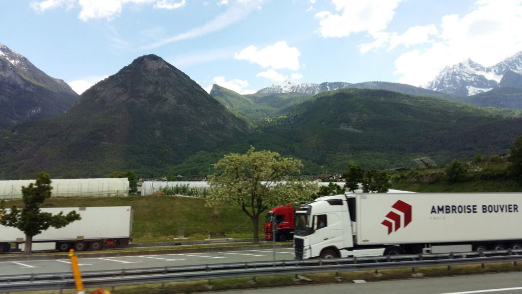 Trucks on the road near Italian Alps